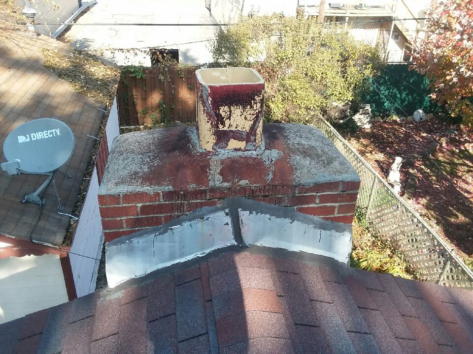 This is a before image of a chimney in dire need of repair in Toledo Ohio 2018